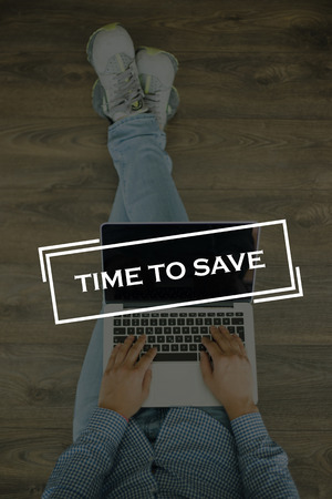 frugality: Young man sitting on floor with laptop and TIME TO SAVE concept on screen