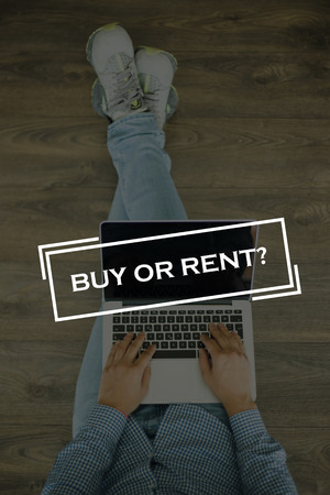buying questions: Young man sitting on floor with laptop and BUY OR RENT? concept on screen