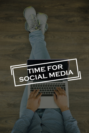 textcloud: Young man sitting on floor with laptop and  TIME FOR SOCIAL MEDIA concept on screen Stock Photo