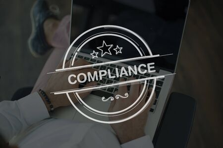 compliant: People Using Laptop and COMPLIANCE Concept Stock Photo