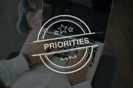 priorities: People Using Laptop and PRIORITIES Concept