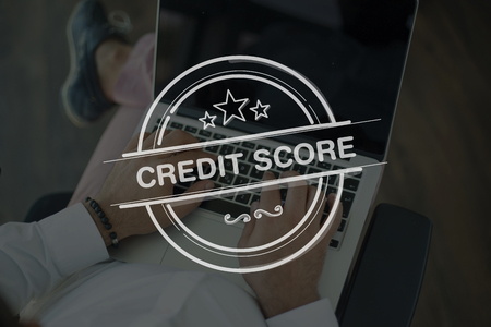 repay: People Using Laptop and CREDIT SCORE Concept Stock Photo