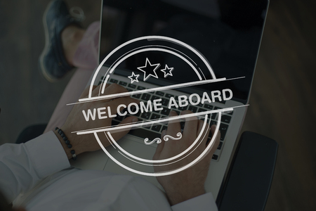 aboard: People Using Laptop and WELCOME ABOARD Concept