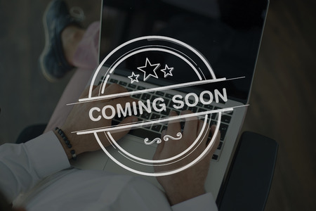 presently: People Using Laptop and COMING SOON Concept