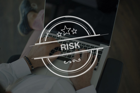 risky situation: People Using Laptop and RISK Concept