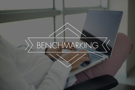 benchmarking: People Using Laptop and BENCHMARKING Concept Stock Photo