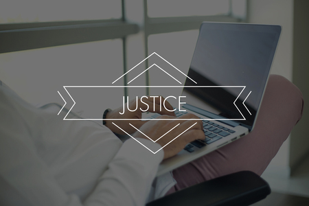 judicature: People Using Laptop and JUSTICE Concept