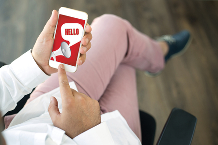 english ethnicity: People using smart phone and HELLO announcement concept on screen Stock Photo