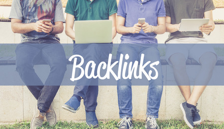 backlinks: Group of people using mobile devices and BACKLINKS concept
