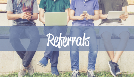 referidos: Group of people using mobile devices and REFERRALS concept Foto de archivo