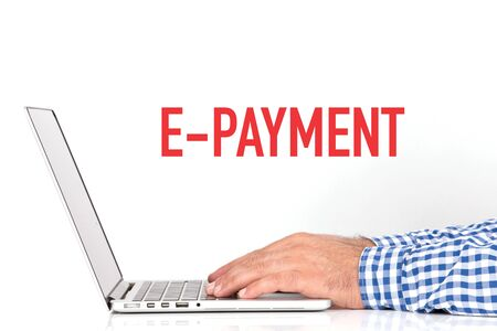 epayment: Young man working on desk and E-PAYMENT concept on white background