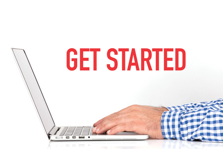registering: Young man working on desk and GET STARTED concept on white background