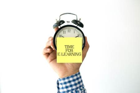 instances: Hand Holding Alarm Clock and Pointing TIME FOR E-LEARNING