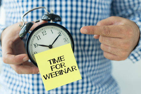 livestream: Hand Holding Alarm Clock and Pointing TIME FOR WEBINAR