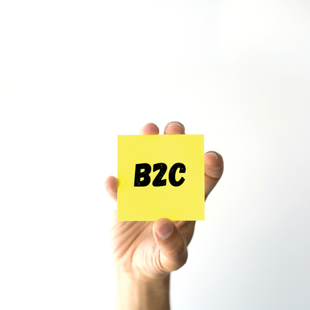 b2c: Hand holding yellow sticky note written B2C word Stock Photo