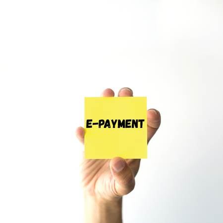 epayment: Hand holding yellow sticky note written E-PAYMENT