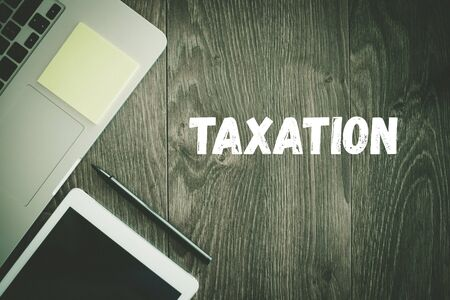 taxation: BUSINESS WORKPLACE TECHNOLOGY OFFICE TAXATION CONCEPT
