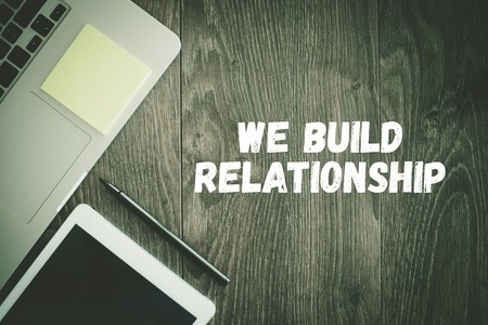 social grace: BUSINESS WORKPLACE TECHNOLOGY OFFICE WE BUILD RELATIONSHIP CONCEPT Stock Photo