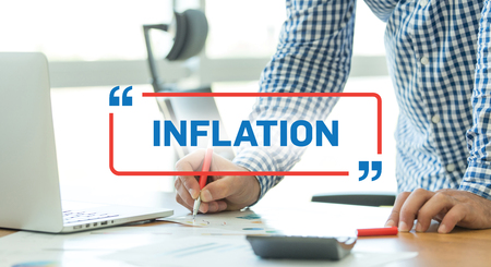 price uncertainty: BUSINESS WORKING OFFICE BUSINESSMAN INFLATION CONCEPT
