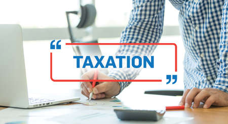 rate of return: BUSINESS WORKING OFFICE BUSINESSMAN TAXATION CONCEPT Stock Photo