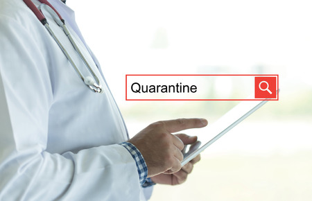 contagion: DOCTOR USING TABLET PC AND SEARCHING QUARANTINE ON WEB
