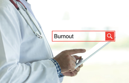 doctor burnout: DOCTOR USING TABLET PC AND SEARCHING BURNOUT ON WEB