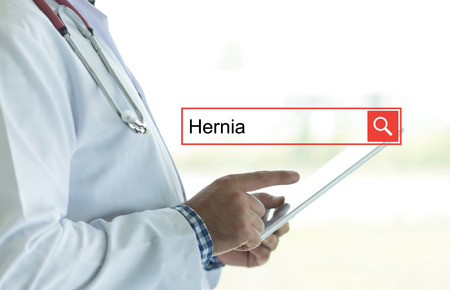 DOCTOR USING TABLET PC AND SEARCHING HERNIA ON WEB