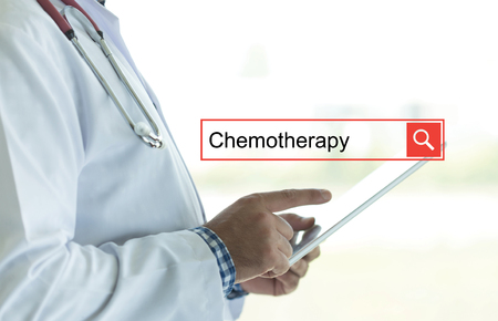 radiotherapy: DOCTOR USING TABLET PC AND SEARCHING CHEMOTHERAPY ON WEB Stock Photo