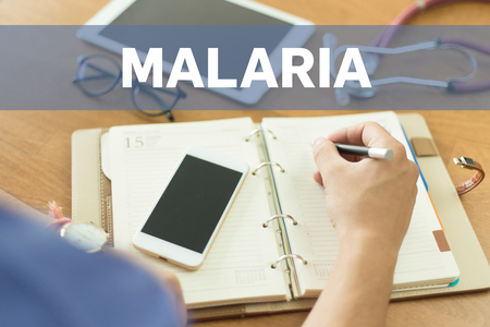 malaria: MEDICAL DOCTOR WORKING OFFICE AND MALARIA CONCEPT Stock Photo