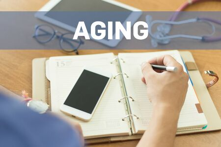 aging: MEDICAL DOCTOR WORKING OFFICE AND AGING CONCEPT