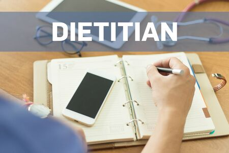 dietology: MEDICAL DOCTOR WORKING OFFICE AND DIETITIAN CONCEPT Stock Photo