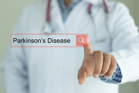DOCTOR WORKING MODERN INTERFACE TOUCHSCREEN SEARCHING AND PARKINSONS DISEASE  CONCEPT