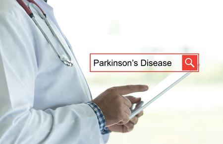 motor neuron: DOCTOR USING TABLET PC AND SEARCHING PARKINSONS DISEASE ON WEB
