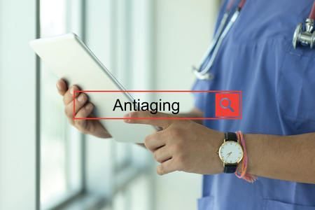 antiaging: DOCTOR USING TABLET PC SEARCHING ANTIAGING