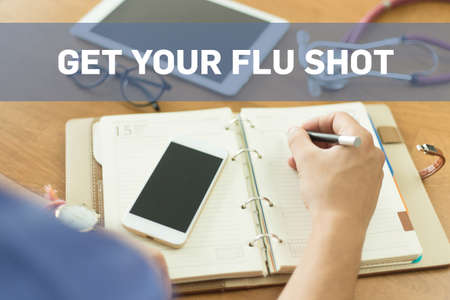 swine flu vaccines: MEDICAL DOCTOR WORKING OFFICE AND GET YOUR FLU SHOT CONCEPT