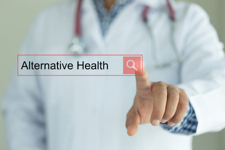 alternative health: DOCTOR WORKING MODERN INTERFACE TOUCHSCREEN SEARCHING AND ALTERNATIVE HEALTH  CONCEPT Stock Photo