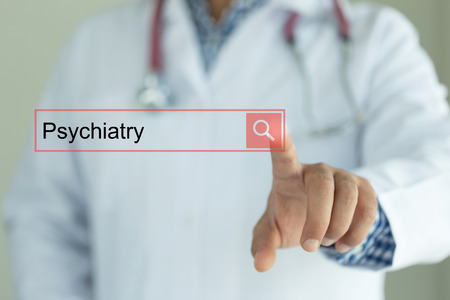DOCTOR WORKING MODERN INTERFACE TOUCHSCREEN SEARCHING AND PSYCHIATRY  CONCEPT Stock Photo