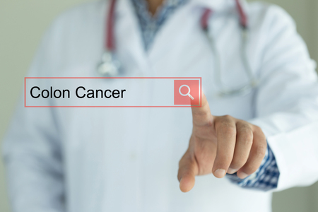 DOCTOR WORKING MODERN INTERFACE TOUCHSCREEN SEARCHING AND COLON CANCER  CONCEPT