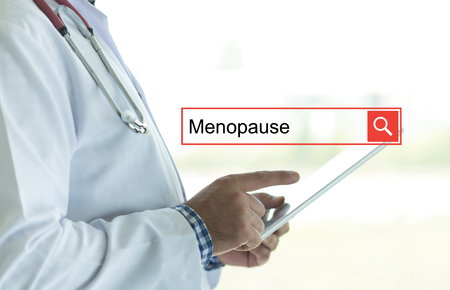 MENOPAUSE: DOCTOR USING TABLET PC AND SEARCHING MENOPAUSE ON WEB