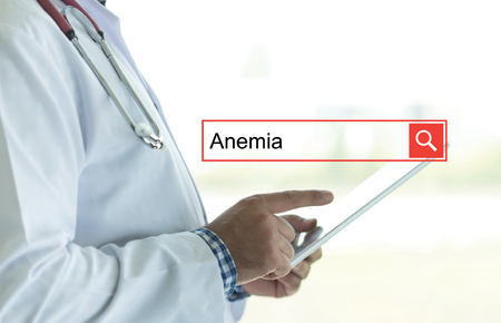 anemia: DOCTOR USING TABLET PC AND SEARCHING ANEMIA ON WEB