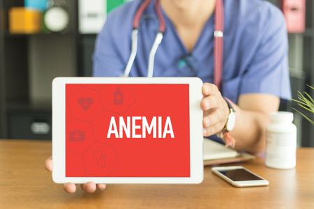 anemia: Young and professional medical doctor showing a tablet pc and ANEMIA concept on screen Stock Photo