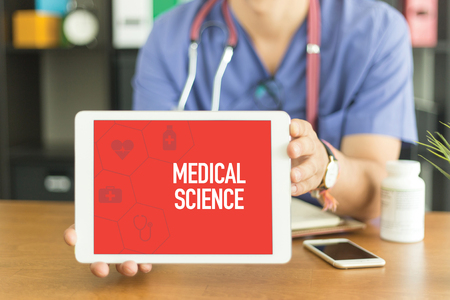 toxic substance: Young and professional medical doctor showing a tablet pc and MEDICAL SCIENCE concept on screen Stock Photo