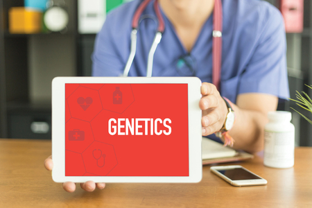genomic: Young and professional medical doctor showing a tablet pc and GENETICS concept on screen