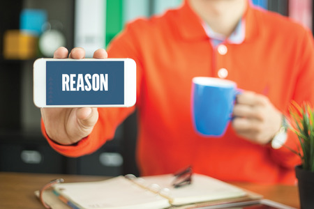 reason: Young man showing smartphone and REASON word concept on screen