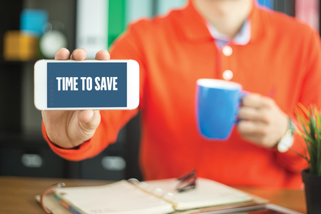 Young man showing smartphone and TIME TO SAVE word concept on screen