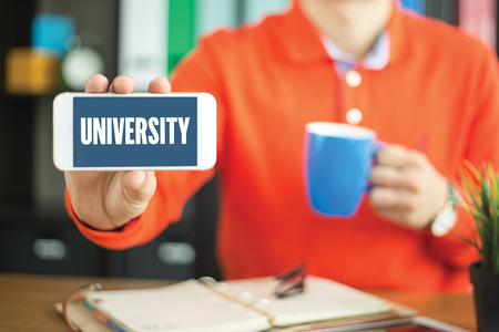 university word: Young man showing smartphone and UNIVERSITY word concept on screen