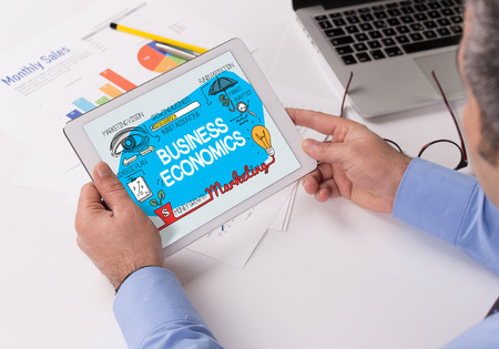 BUSINESS ECONOMICS Concept on Tablet PC Screen