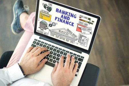 using laptop: People using laptop and BBANKING AND FINANCE concept on screen