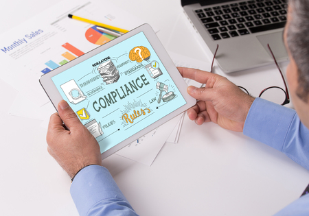 COMPLIANCE Concept on Tablet PC Screen