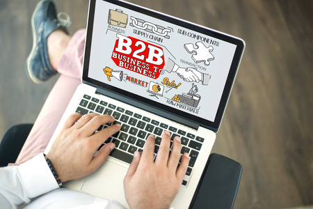 b2b: People using laptop and B2B concept on screen